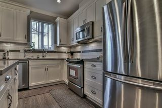 "Photo 14: 10 6929 142 Street in Surrey: East Newton Townhouse for sale in ""East Newton"" : MLS®# R2206019"
