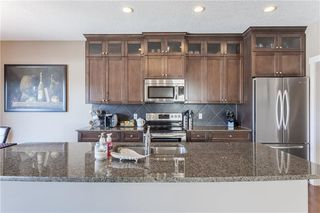 Photo 5: 128 DRAKE LANDING Green: Okotoks House for sale : MLS®# C4167961