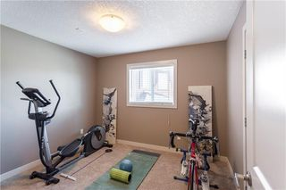 Photo 13: 128 DRAKE LANDING Green: Okotoks House for sale : MLS®# C4167961