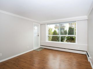 "Photo 3: 113 8680 FREMLIN Street in Vancouver: Marpole Condo for sale in ""COLONIAL ARMS"" (Vancouver West)  : MLS®# R2416429"