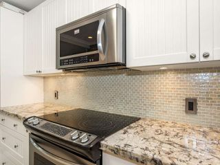 "Photo 11: 113 8680 FREMLIN Street in Vancouver: Marpole Condo for sale in ""COLONIAL ARMS"" (Vancouver West)  : MLS®# R2416429"