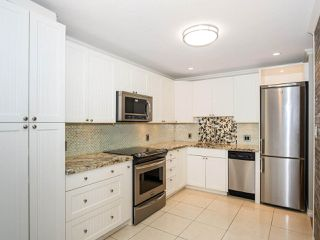 "Photo 6: 113 8680 FREMLIN Street in Vancouver: Marpole Condo for sale in ""COLONIAL ARMS"" (Vancouver West)  : MLS®# R2416429"