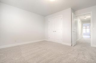 Photo 19: 8 6 Scarpe Drive SW in Calgary: Garrison Woods Row/Townhouse for sale : MLS®# A1057880