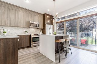 Photo 10: 8 6 Scarpe Drive SW in Calgary: Garrison Woods Row/Townhouse for sale : MLS®# A1057880
