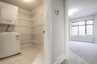 Photo 27: 8 6 Scarpe Drive SW in Calgary: Garrison Woods Row/Townhouse for sale : MLS®# A1057880