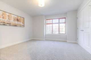 Photo 21: 8 6 Scarpe Drive SW in Calgary: Garrison Woods Row/Townhouse for sale : MLS®# A1057880