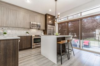 Photo 11: 8 6 Scarpe Drive SW in Calgary: Garrison Woods Row/Townhouse for sale : MLS®# A1057880