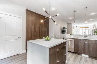 Photo 12: 8 6 Scarpe Drive SW in Calgary: Garrison Woods Row/Townhouse for sale : MLS®# A1057880