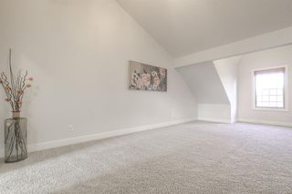 Photo 32: 8 6 Scarpe Drive SW in Calgary: Garrison Woods Row/Townhouse for sale : MLS®# A1057880
