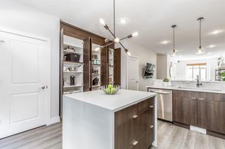 Photo 13: 8 6 Scarpe Drive SW in Calgary: Garrison Woods Row/Townhouse for sale : MLS®# A1057880