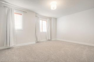 Photo 17: 8 6 Scarpe Drive SW in Calgary: Garrison Woods Row/Townhouse for sale : MLS®# A1057880