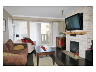 "Photo 2: 226 801 KLAHANIE Drive in Port Moody: Port Moody Centre Condo for sale in ""INGLENOOK"" : MLS®# V869106"