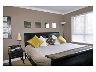 "Photo 1: 226 801 KLAHANIE Drive in Port Moody: Port Moody Centre Condo for sale in ""INGLENOOK"" : MLS®# V869106"