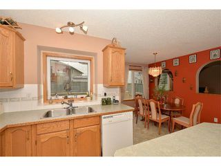 Photo 10: 38 WEST HALL Place: Cochrane House for sale : MLS®# C4011661
