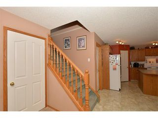 Photo 7: 38 WEST HALL Place: Cochrane House for sale : MLS®# C4011661