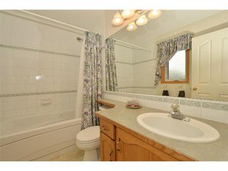 Photo 15: 38 WEST HALL Place: Cochrane House for sale : MLS®# C4011661