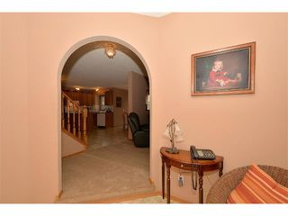 Photo 4: 38 WEST HALL Place: Cochrane House for sale : MLS®# C4011661