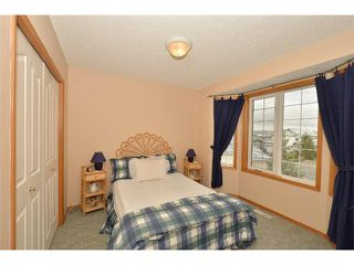 Photo 16: 38 WEST HALL Place: Cochrane House for sale : MLS®# C4011661