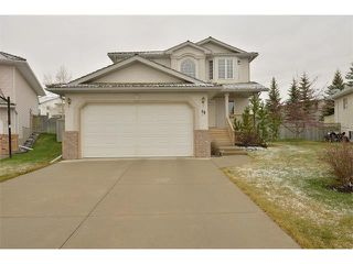 Photo 1: 38 WEST HALL Place: Cochrane House for sale : MLS®# C4011661