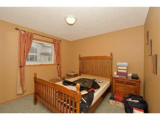 Photo 19: 38 WEST HALL Place: Cochrane House for sale : MLS®# C4011661