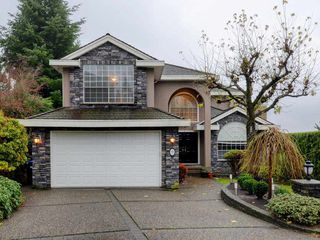 "Photo 1: 9 GREYSTONE Place in Port Moody: Heritage Mountain House for sale in ""Heritage Mountain"" : MLS®# R2257446"