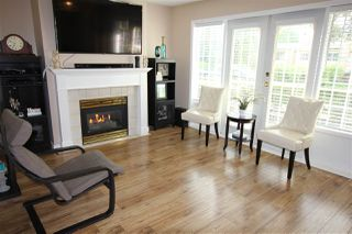 "Photo 1: 103 15258 105 Avenue in Surrey: Guildford Townhouse for sale in ""GEORGIAN GARDENS"" (North Surrey)  : MLS®# R2369939"