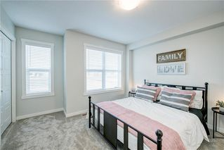 Photo 18: 122 Cranbrook Square SE in Calgary: Cranston Row/Townhouse for sale : MLS®# C4256095
