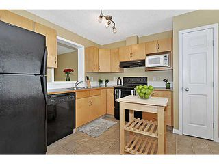 Photo 6: 103 EVERHOLLOW Heights SW in CALGARY: Evergreen Townhouse for sale (Calgary)  : MLS®# C3606499