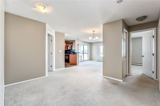 Photo 4: 1318 16969 24 Street SW in Calgary: Bridlewood Condo for sale : MLS®# C4119974