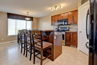 Photo 11: 784 LUXSTONE Landing SW: Airdrie House for sale : MLS®# C4160594