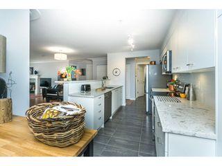 """Photo 4: 319 15210 PACIFIC Avenue: White Rock Condo for sale in """"Ocean Ridge"""" (South Surrey White Rock)  : MLS®# R2259436"""
