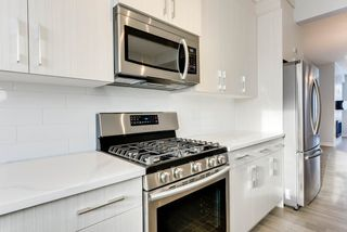 Photo 7: 10518 76 Street in Edmonton: Zone 19 House Half Duplex for sale : MLS®# E4142876