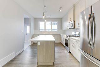 Photo 2: 10518 76 Street in Edmonton: Zone 19 House Half Duplex for sale : MLS®# E4142876