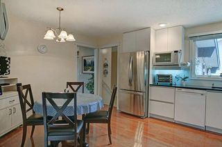 Photo 11: 467 QUEENSLAND Circle SE in Calgary: Queensland Detached for sale : MLS®# C4236793