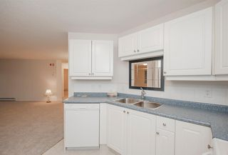 Photo 2: 1111 Millrise Point SW in Calgary: Millrise Apartment for sale : MLS®# A1043747