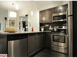 "Photo 4: 316 13468 KING GEORGE Boulevard in Surrey: Whalley Condo for sale in ""The Brookland"" (North Surrey)  : MLS®# F1127520"