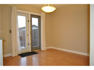 Photo 4: 557 SUMMERWOOD Place SE: Airdrie Residential Attached for sale : MLS®# C3592604