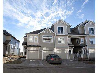 Photo 2: 153 300 EVANSCREEK Court NW in CALGARY: Evanston Townhouse for sale (Calgary)  : MLS®# C3598131