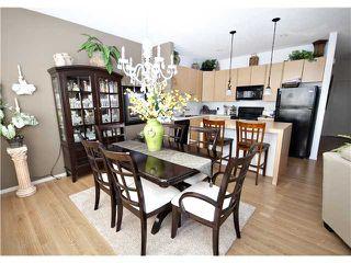 Photo 5: 153 300 EVANSCREEK Court NW in CALGARY: Evanston Townhouse for sale (Calgary)  : MLS®# C3598131