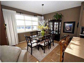 Photo 4: 153 300 EVANSCREEK Court NW in CALGARY: Evanston Townhouse for sale (Calgary)  : MLS®# C3598131