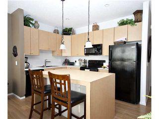 Photo 7: 153 300 EVANSCREEK Court NW in CALGARY: Evanston Townhouse for sale (Calgary)  : MLS®# C3598131