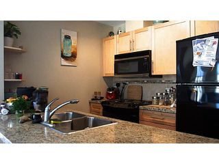 "Photo 6: 411 1211 VILLAGE GREEN Way in Squamish: Downtown SQ Condo for sale in ""ROCKCLIFFE"" : MLS®# V1097477"