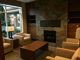 "Photo 2: 411 1211 VILLAGE GREEN Way in Squamish: Downtown SQ Condo for sale in ""ROCKCLIFFE"" : MLS®# V1097477"