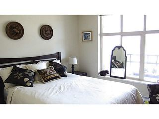 "Photo 3: 411 1211 VILLAGE GREEN Way in Squamish: Downtown SQ Condo for sale in ""ROCKCLIFFE"" : MLS®# V1097477"