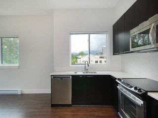 "Photo 12: 402 2362 WHYTE Avenue in Port Coquitlam: Central Pt Coquitlam Condo for sale in ""AQUILA"" : MLS®# R2070392"