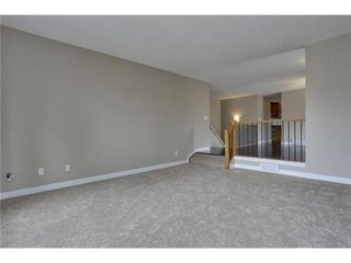 Photo 12: 4 WOODBROOK Way SW in Calgary: Bungalow for sale : MLS®# C3517374