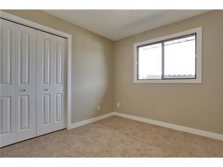 Photo 17: 4 WOODBROOK Way SW in Calgary: Bungalow for sale : MLS®# C3517374