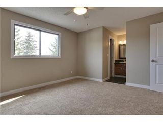 Photo 15: 4 WOODBROOK Way SW in Calgary: Bungalow for sale : MLS®# C3517374