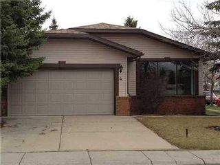 Photo 1: 4 WOODBROOK Way SW in Calgary: Bungalow for sale : MLS®# C3517374