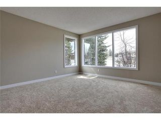 Photo 11: 4 WOODBROOK Way SW in Calgary: Bungalow for sale : MLS®# C3517374